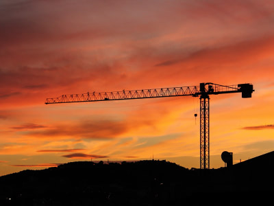 Crane being operated at sunrise